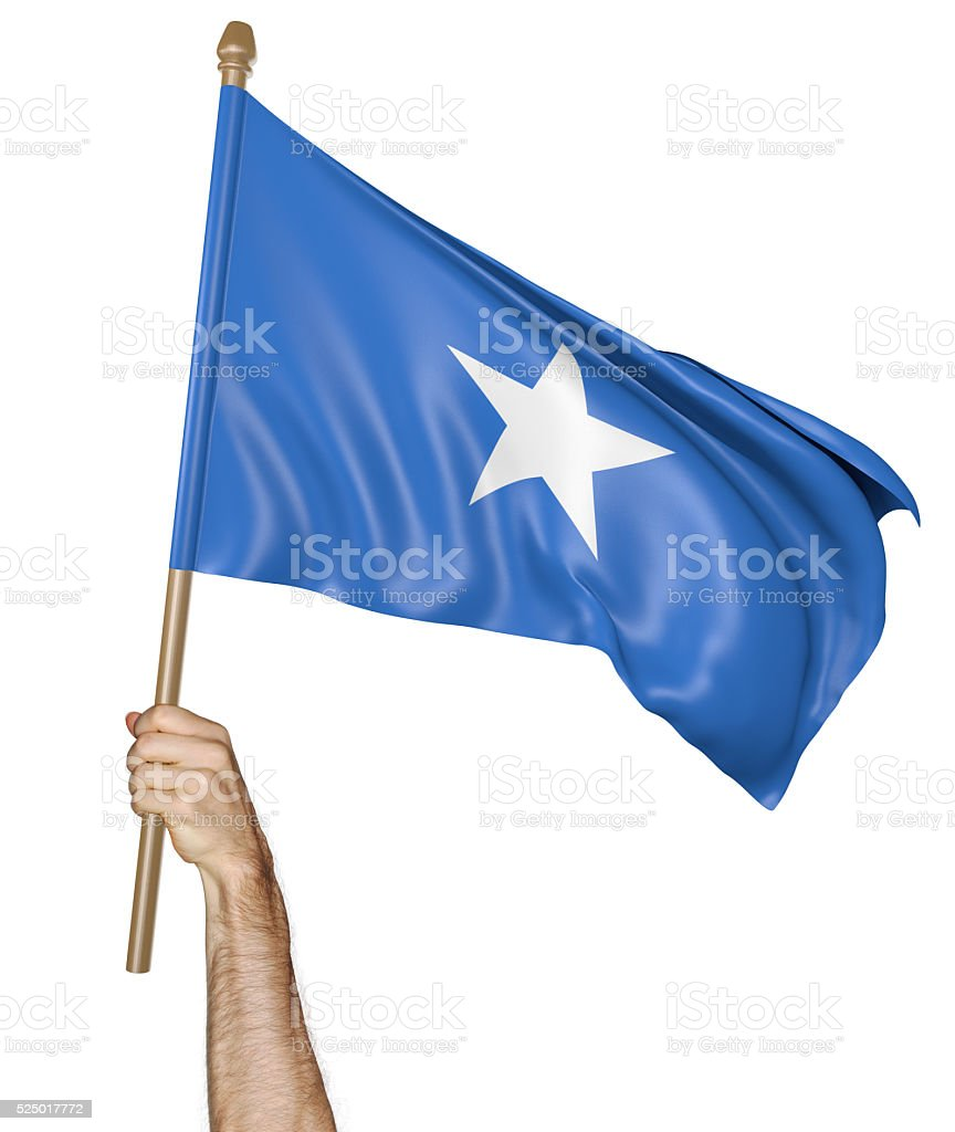Hand proudly waving the national flag of Somalia stock photo