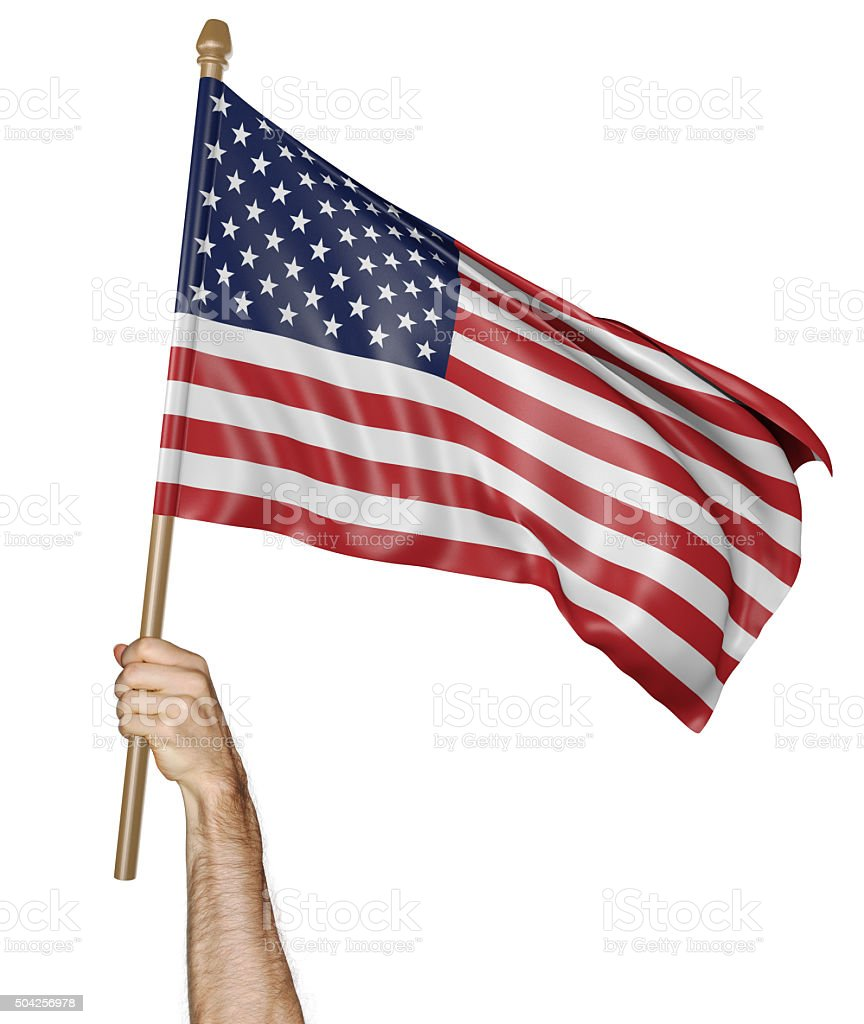 Hand proudly waving the national flag of the United States stock photo