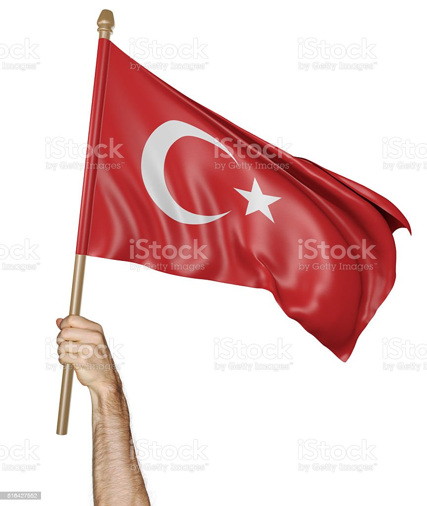 Hand proudly waving the national flag of Turkey stock photo