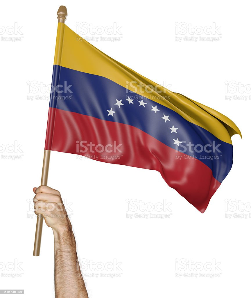 Hand proudly waving the national flag of Venezuela stock photo