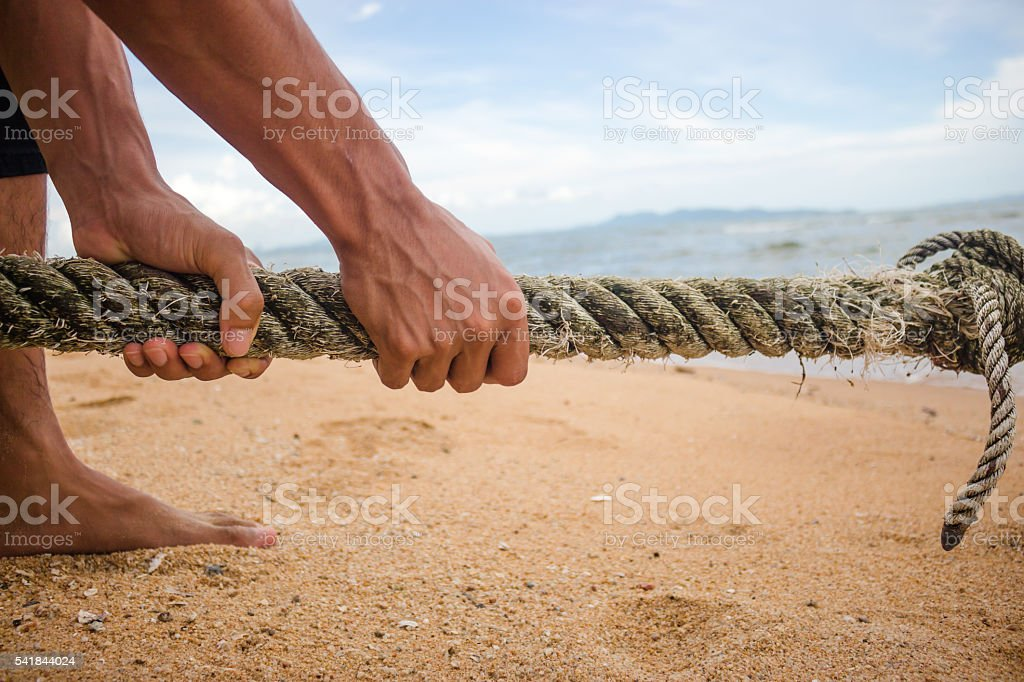 Hand pull a rope. stock photo