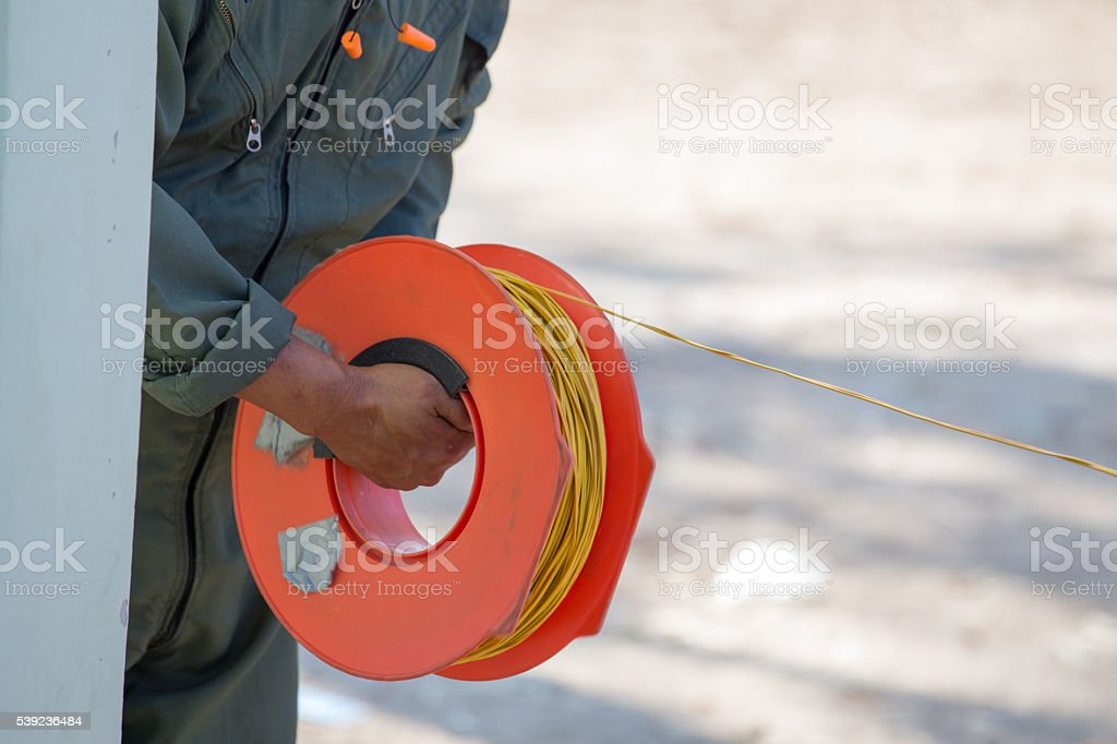 hand pull power cable for bomb disposal stock photo