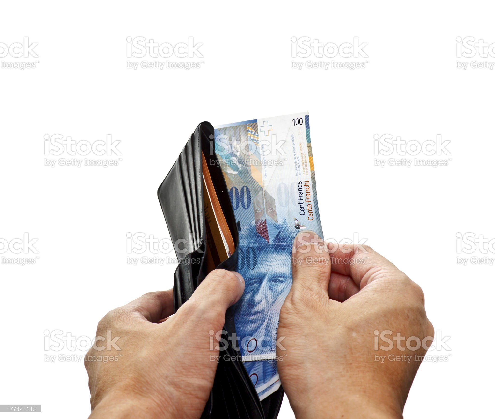 hand pulling banknotes from wallet royalty-free stock photo