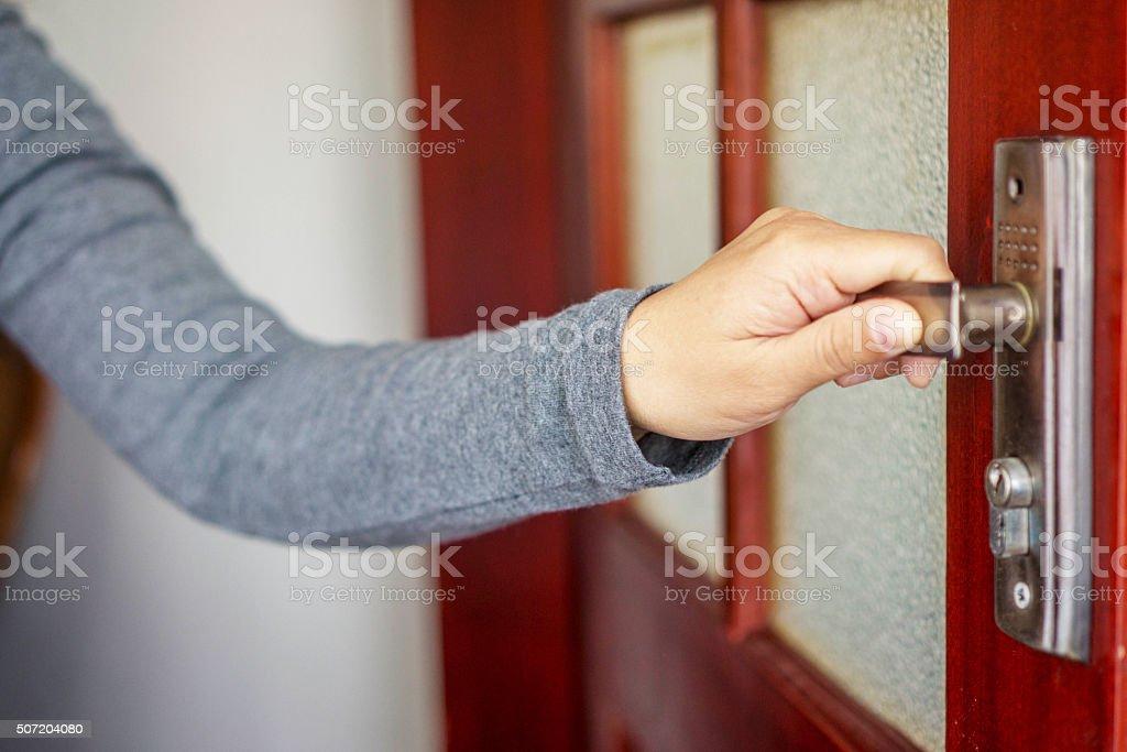 hand pulling door handle stock photo