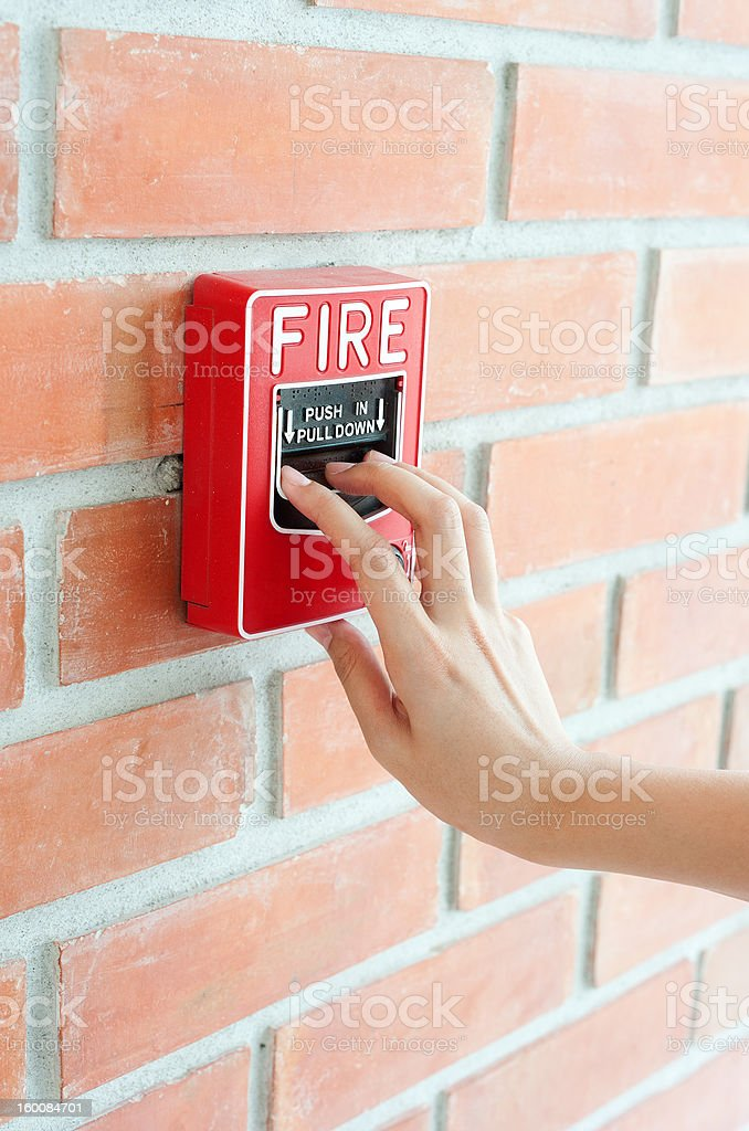 Hand pulling down fire alarm royalty-free stock photo