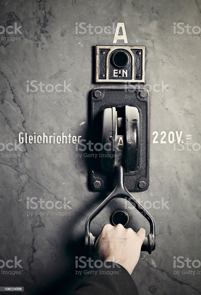 Hand Pulling Lever of Power Switch, Toned stock photo