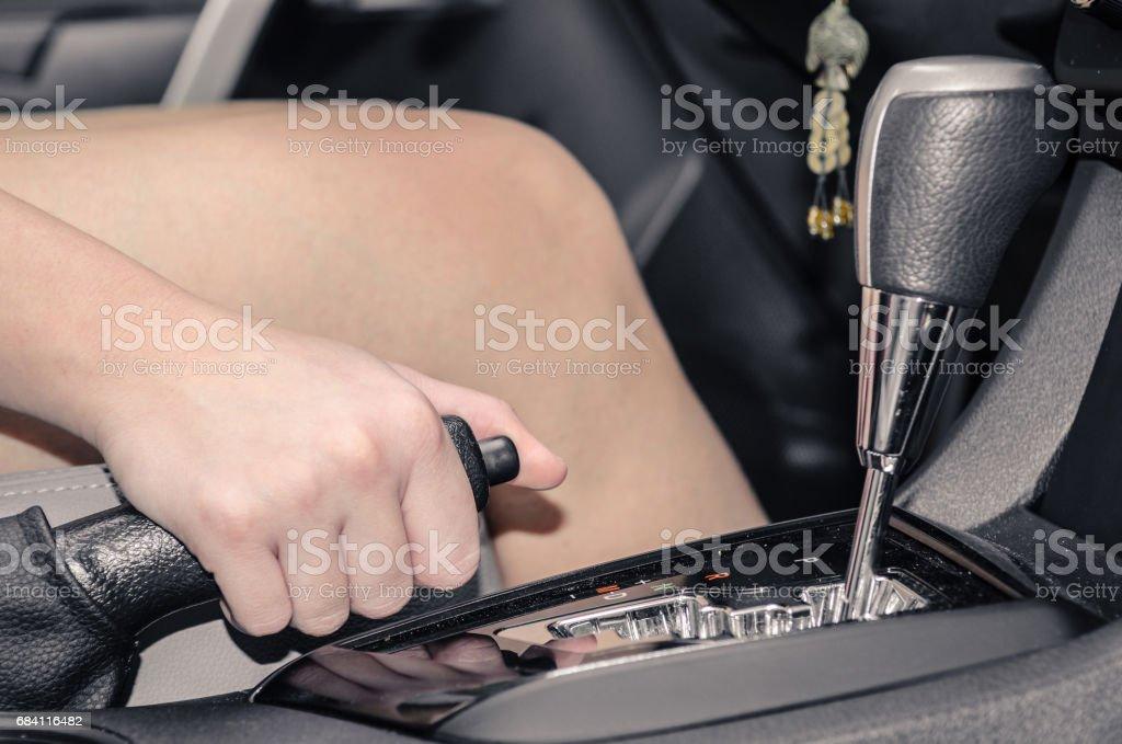 Hand pulling the car handbrake stock photo