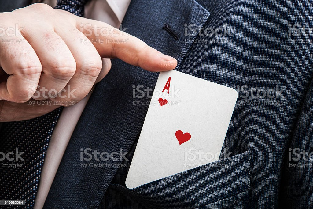 hand pulls the card ace of hearts stock photo