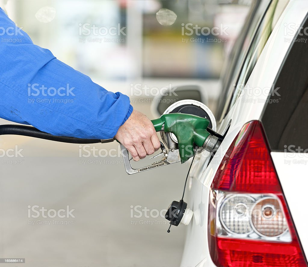 Hand Pumping Gasoline royalty-free stock photo