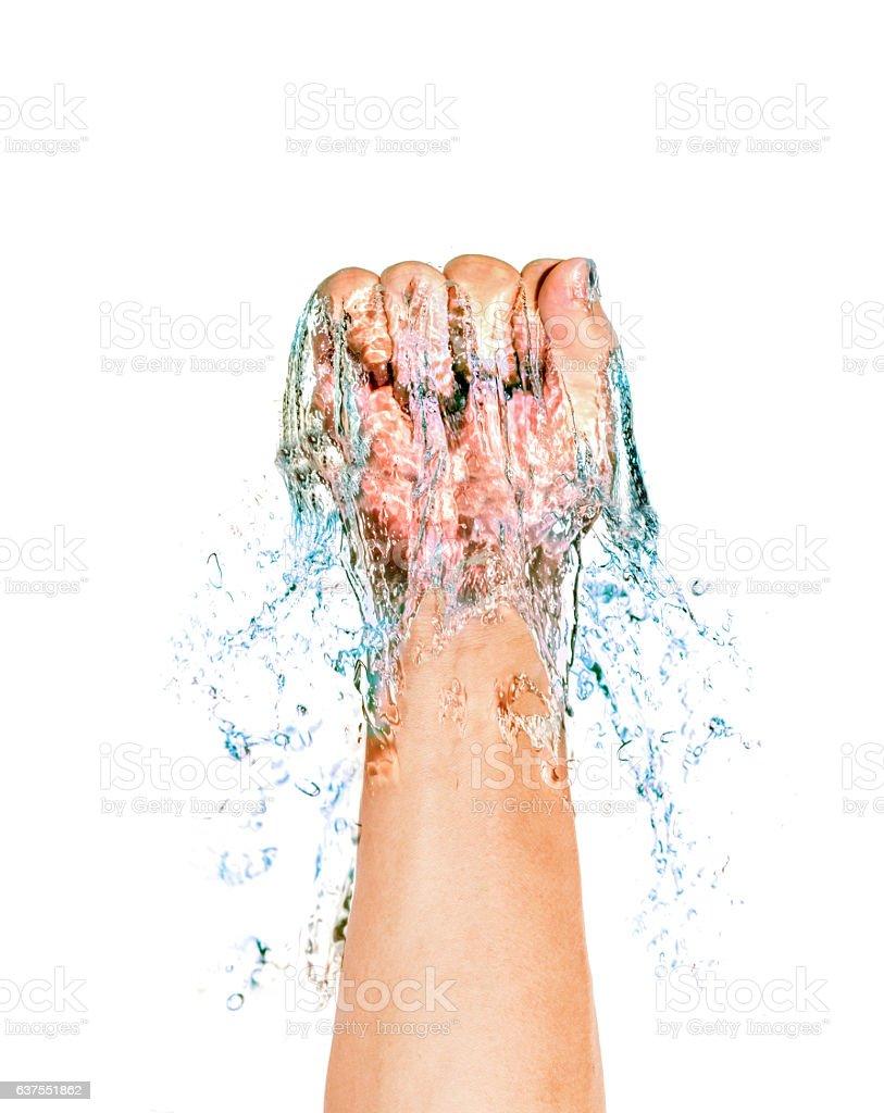 hand punching water. splash. black background stock photo