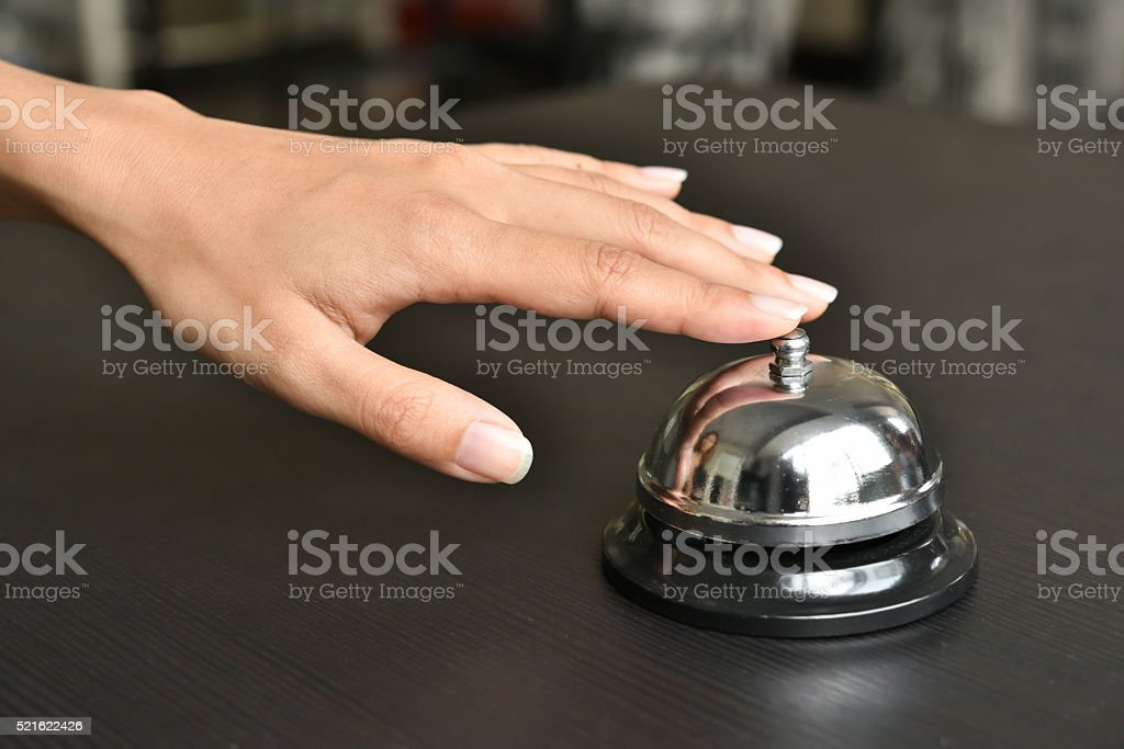 hand push service bell on wooden table. stock photo