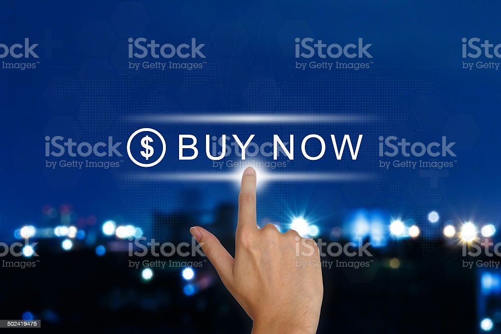 hand pushing buy now button on touch screen stock photo