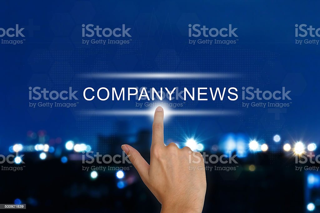 hand pushing company news button on touch screen stock photo