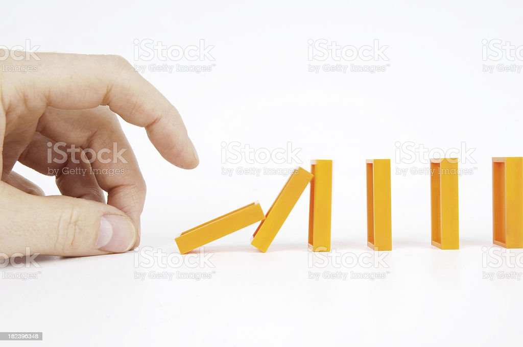 hand pushing dominoes royalty-free stock photo