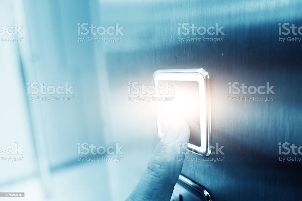 Hand pushing elevator button stock photo