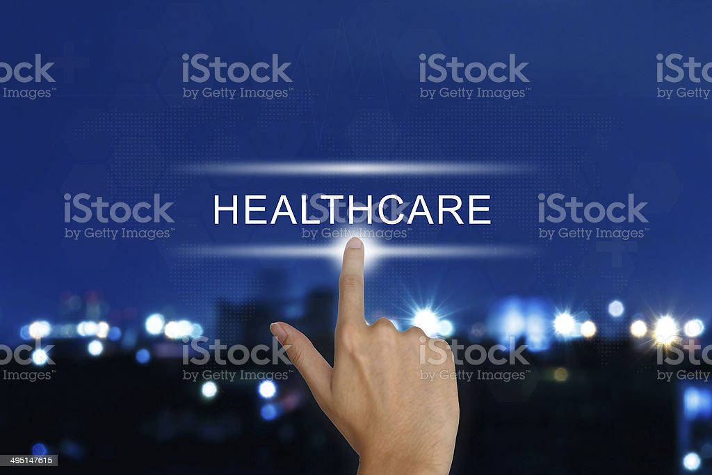 hand pushing healthcare button on touch screen stock photo