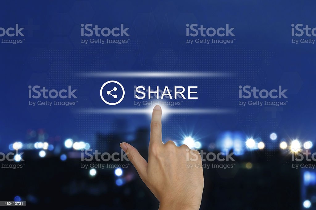 hand pushing share button on touch screen stock photo