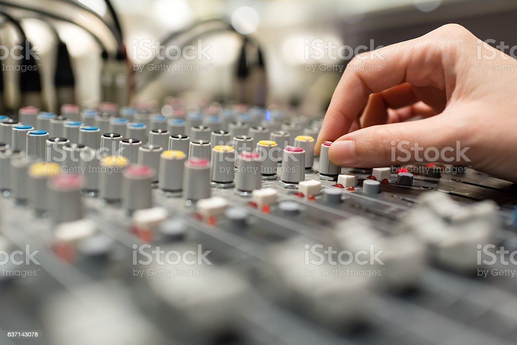 hand pushing sound equalizer button stock photo