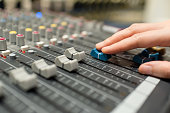 hand pushing sound equalizer button