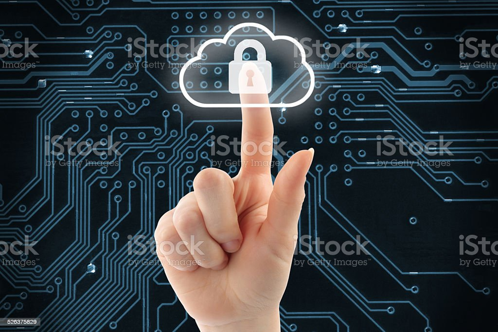 Hand pushing virtual cloud security button stock photo