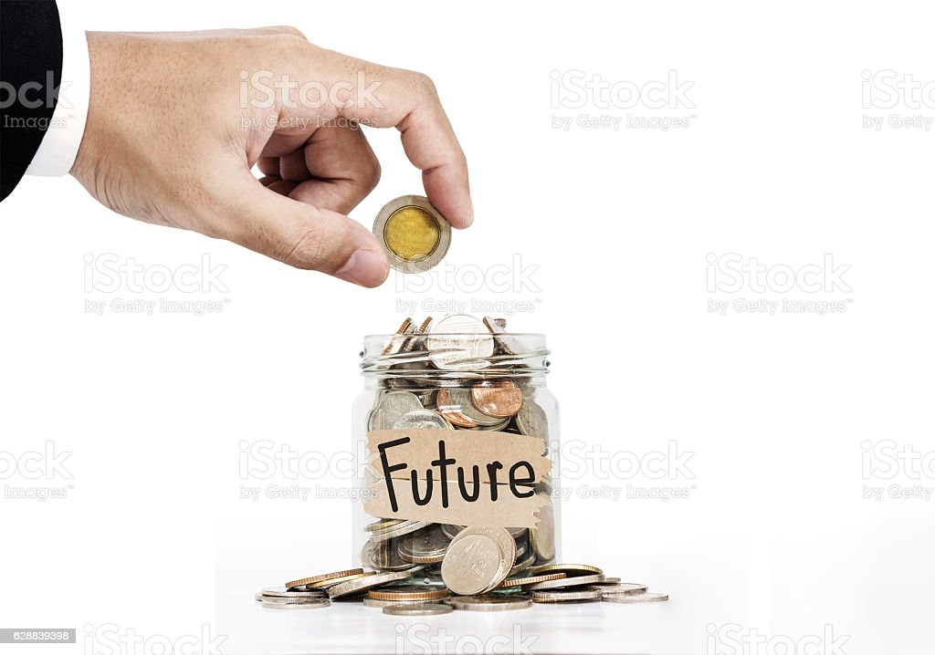 Hand put coin in glass jar, saving money for Future stock photo