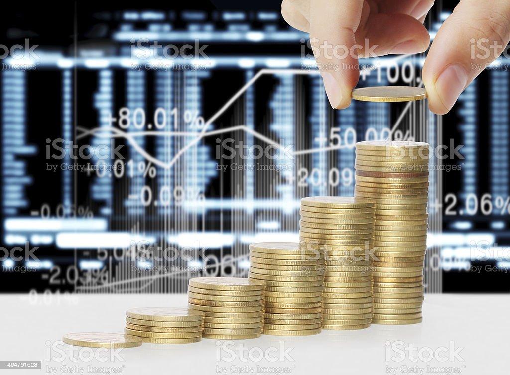 Hand put coin to money stock photo