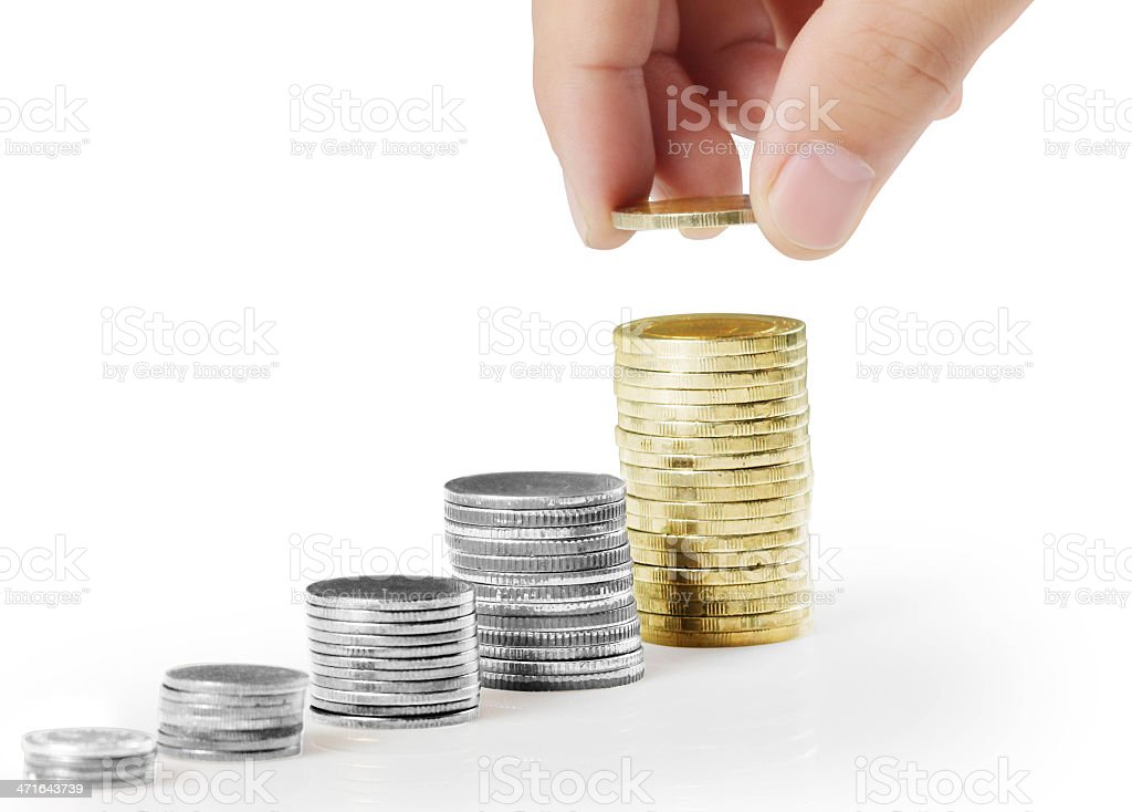 Hand put coin to money royalty-free stock photo