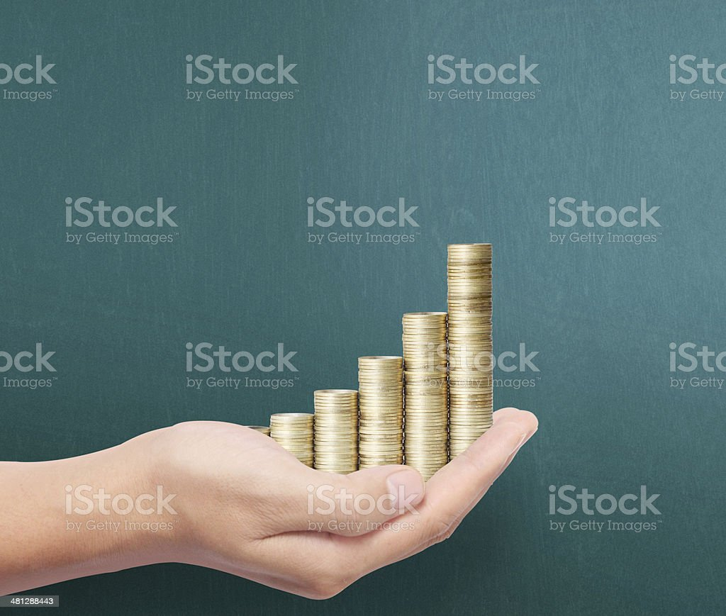 Hand put coin to money stock photo
