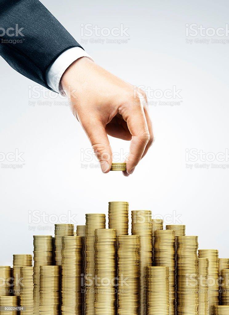 Hand put coins stock photo