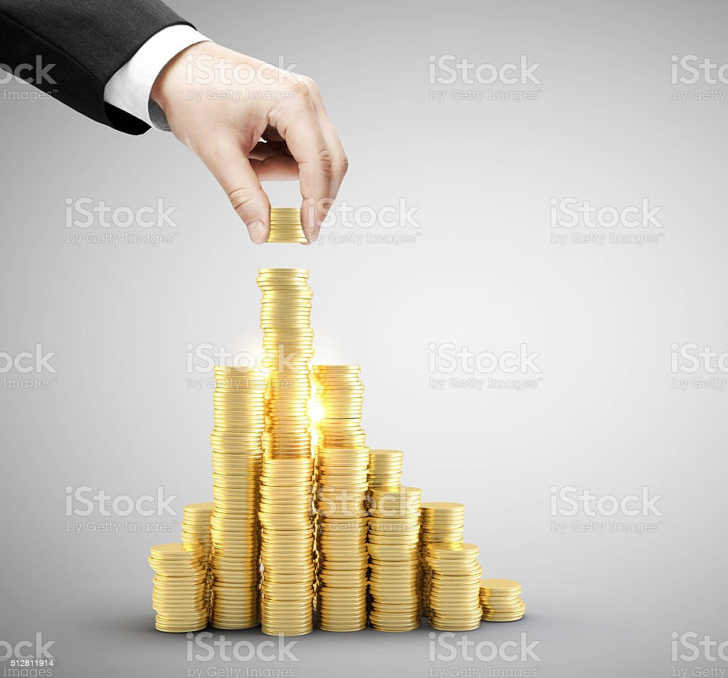 Hand put coins stock photo