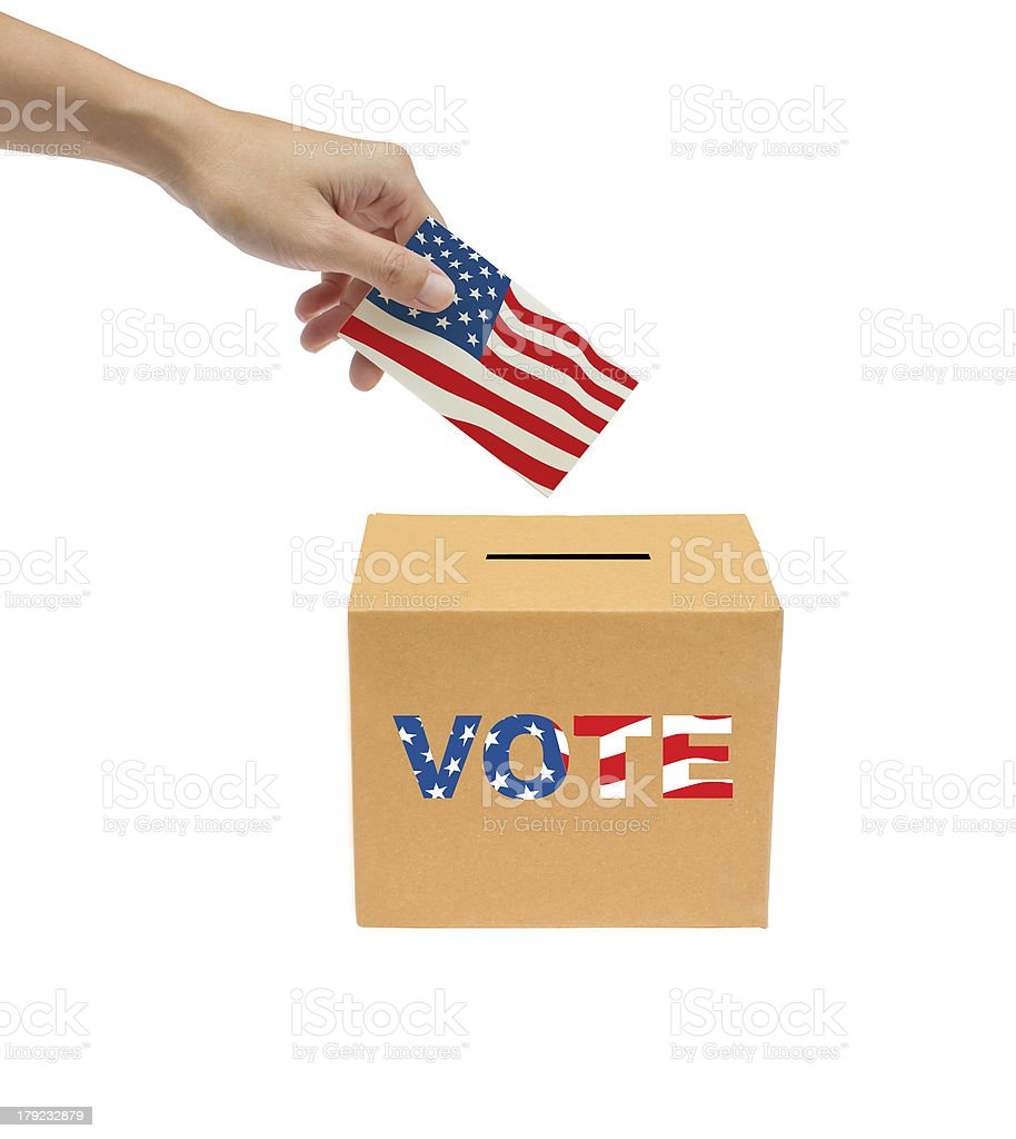 Hand putting a voting bollot into the box. royalty-free stock photo