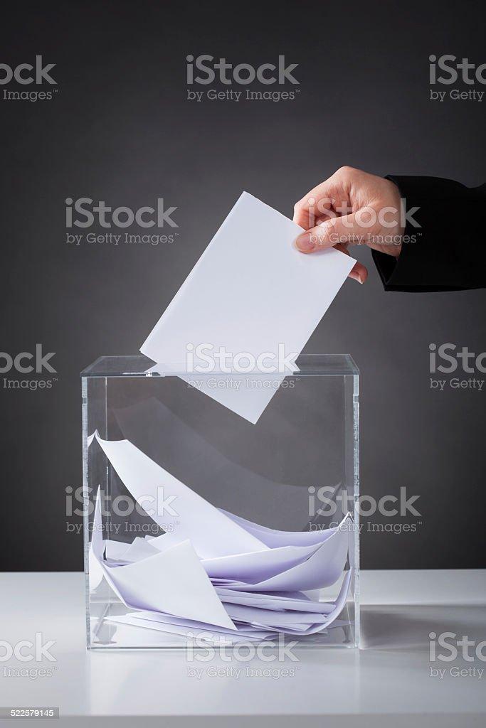 Hand Putting Ballot In Box stock photo