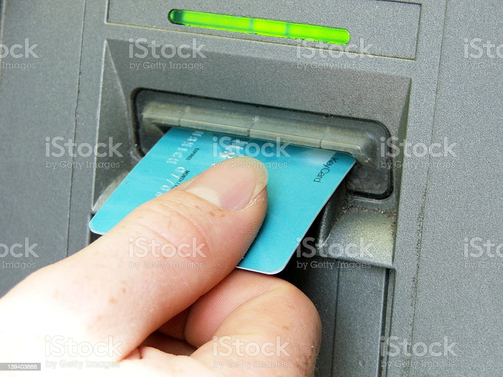 ATM - Hand putting card in stock photo