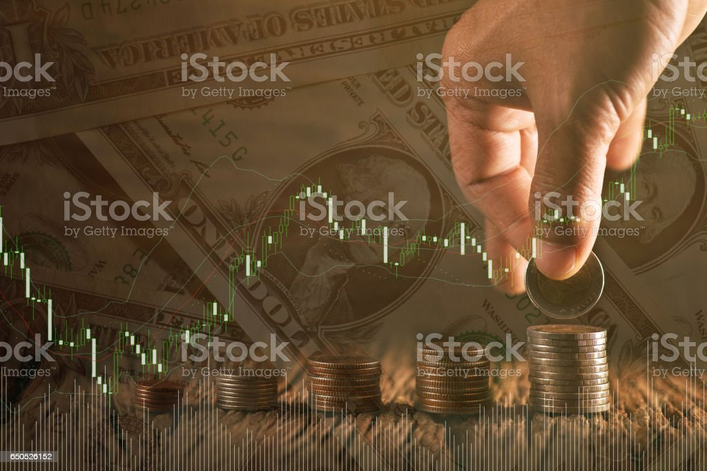 Hand putting money coins stack in finance and banking concept. stock photo