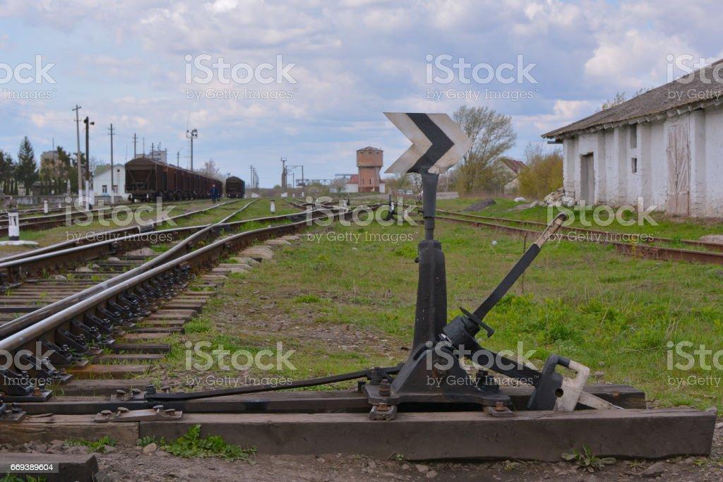 Hand railway switch arrows. Railroad and sky. stock photo