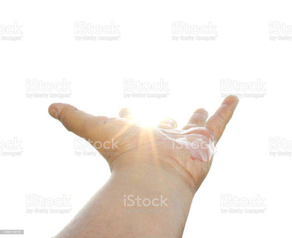 Hand raised towards sky stock photo