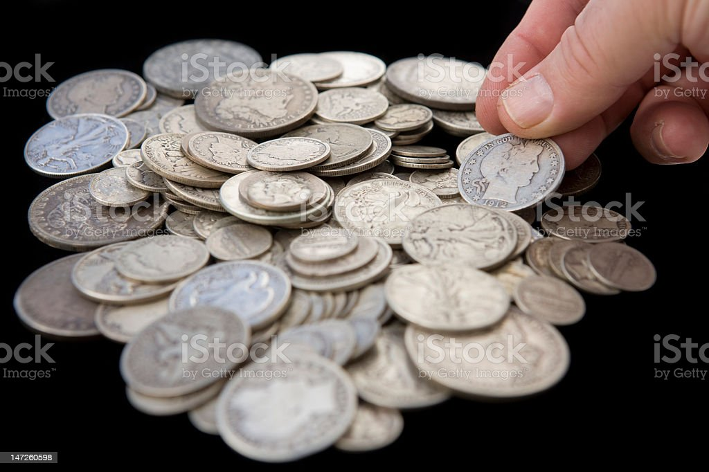 Hand Reaching for Coins from Savings – Horizontal royalty-free stock photo