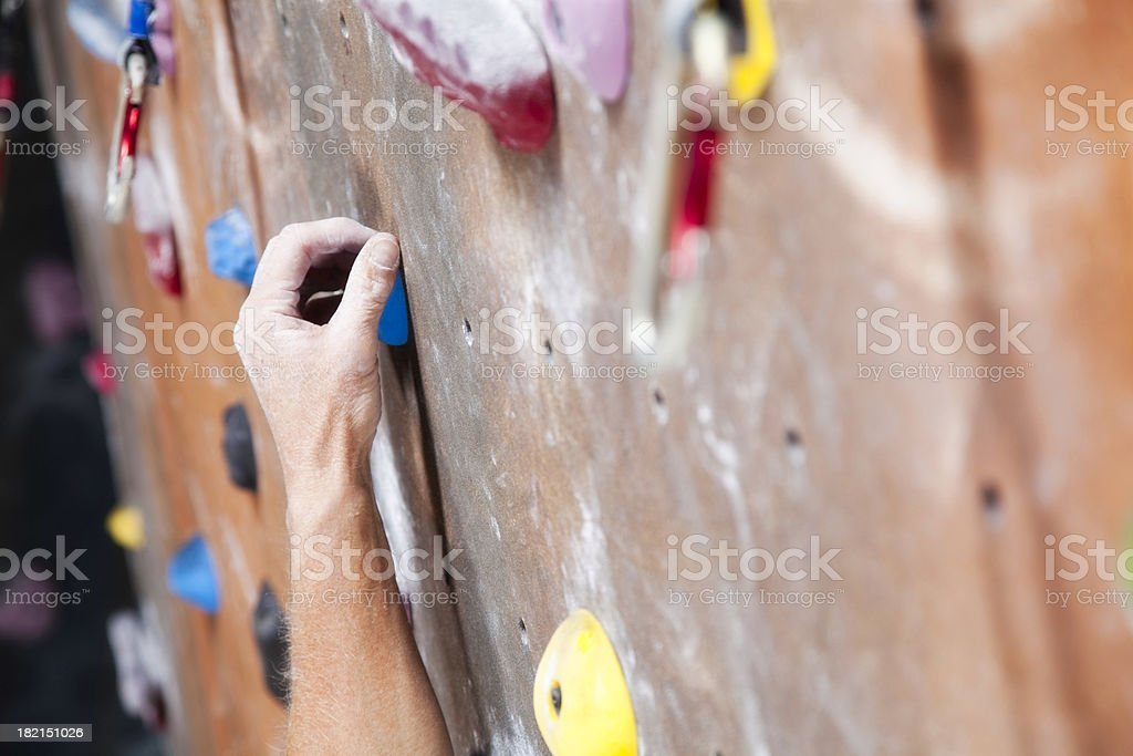 Hand Reaching on Climbing Wall stock photo