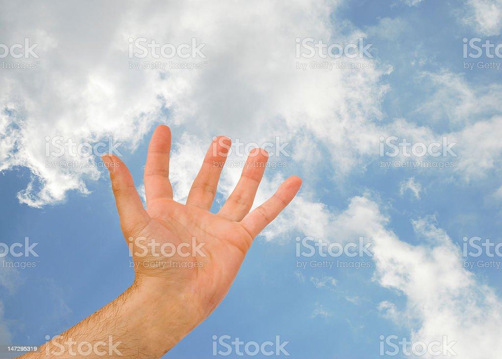 Hand reaching sky stock photo