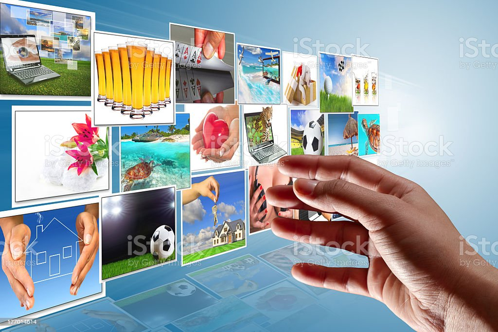 Hand reaching to a multimedia screen royalty-free stock photo