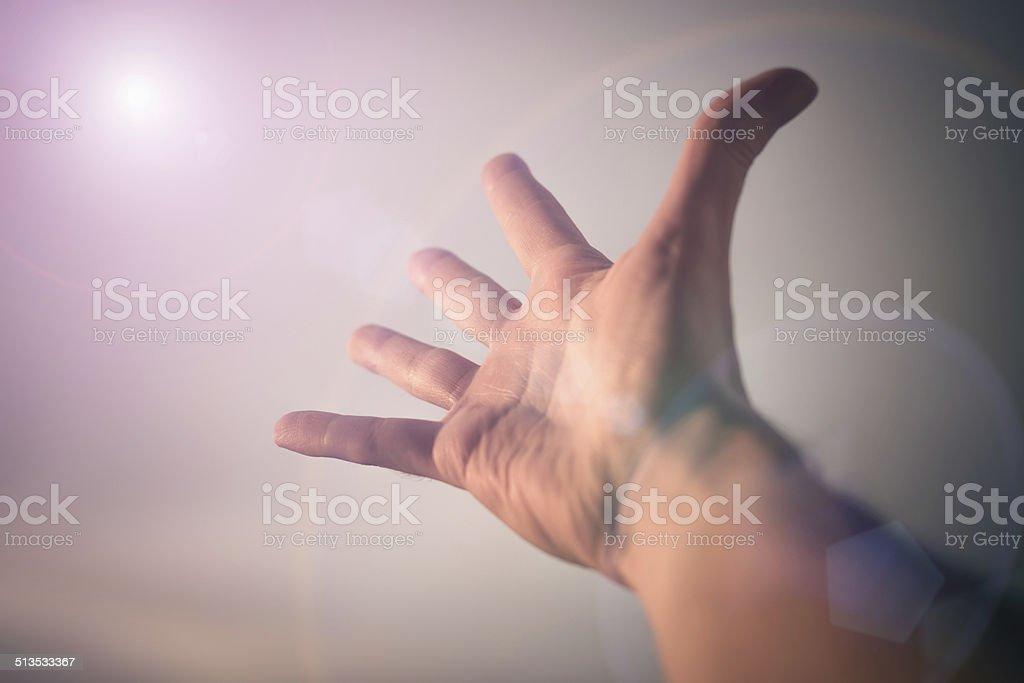 Hand reaching to sky. stock photo
