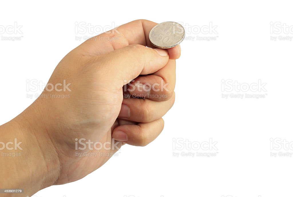 Hand ready to flip coin stock photo