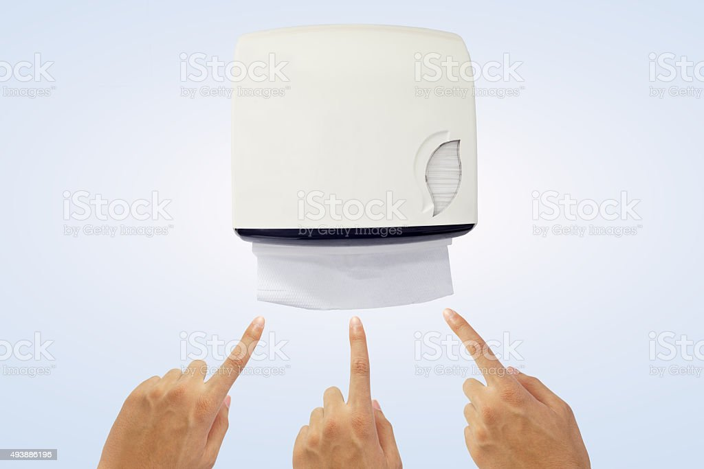 Hand recommend to take tissue paper from tissue dispenser. stock photo