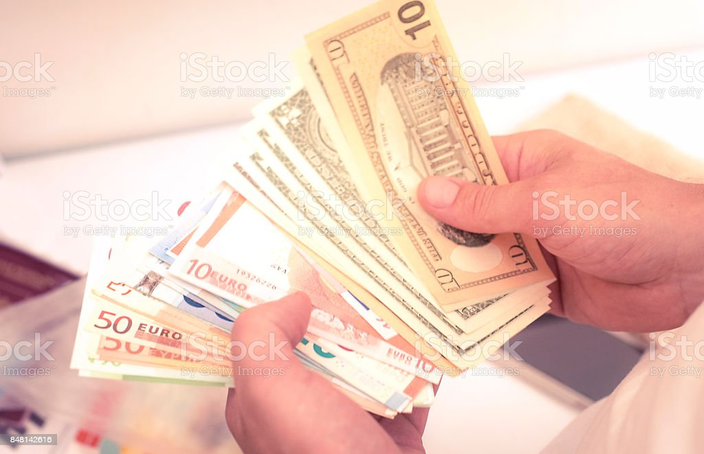 hand recount dollars. the man counts the money. new hundred-dollar bills stock photo