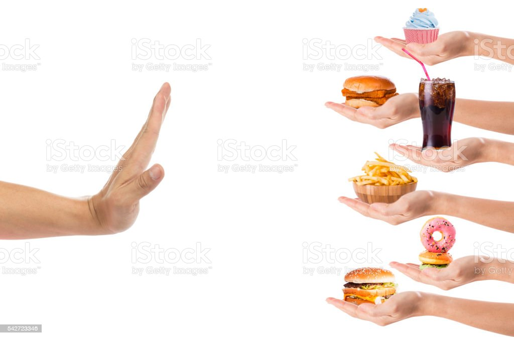 Hand refusing Junk food or fast food concept stock photo