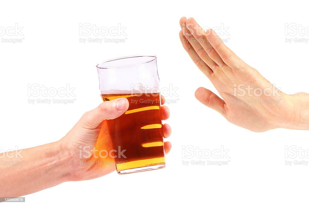 hand reject a glass of beer stock photo