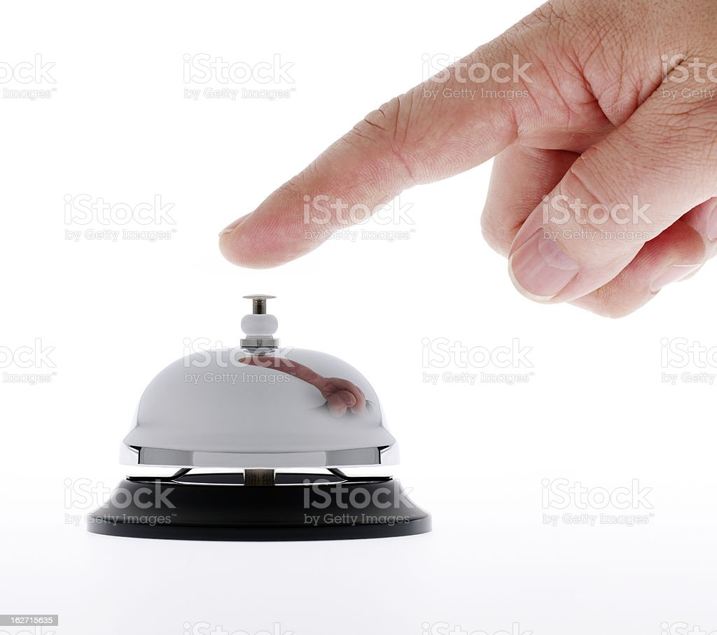 Hand ringing a service bell for assistance royalty-free stock photo