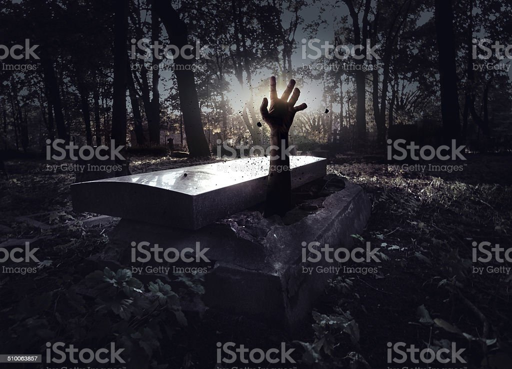 Hand rising out from the grave stock photo