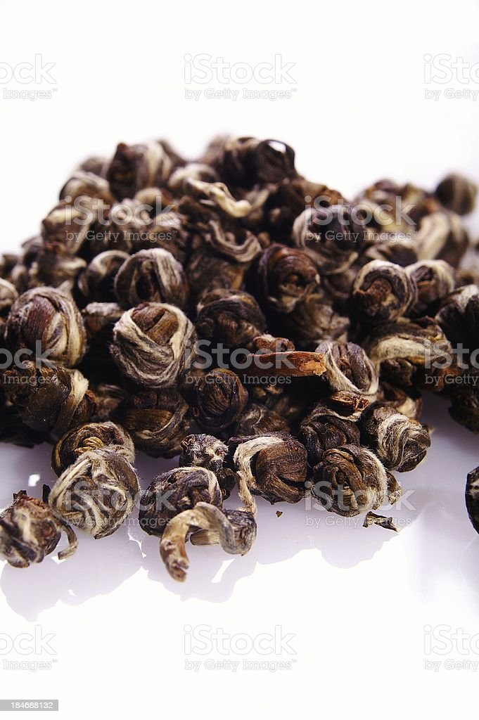 hand rolled oolong tea pearls on white background royalty-free stock photo