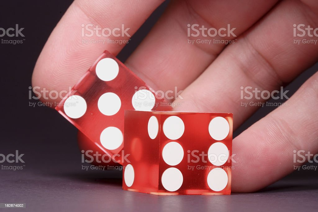 Hand Rolling Casino Dice royalty-free stock photo